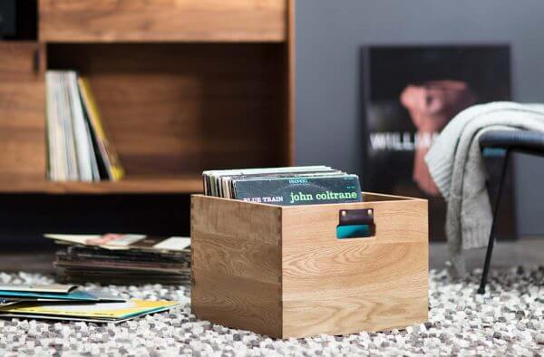 Dovetail Vinyl Record Storage flip bin constructed with premium North American hardwoods. Sitting on a carpeted floor in a living room setting.