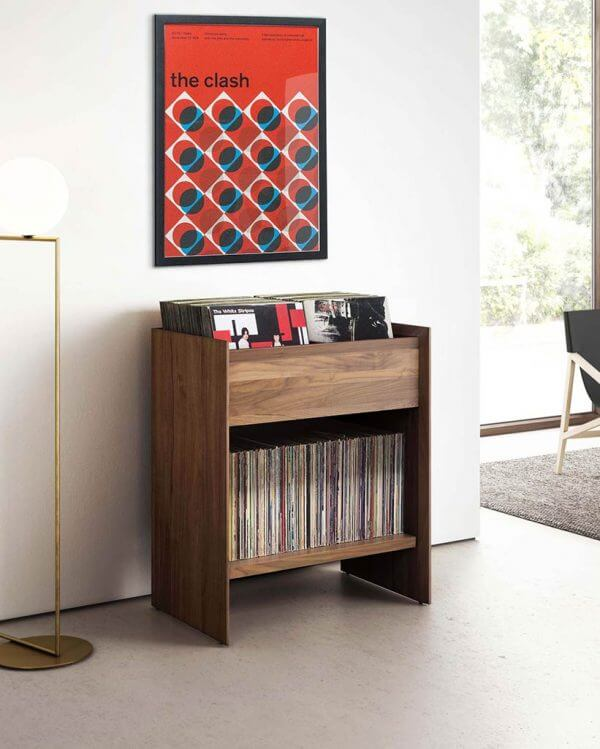 Unison Vinyl Storage Cabinet with flip-style LP storage bins in natural ash finish against a living room wall.