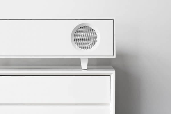 White Tabletop Hifi Bluetooth speakers on white vinyl storage cabinet.